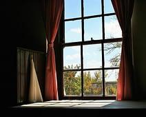 house window with a nice curtain